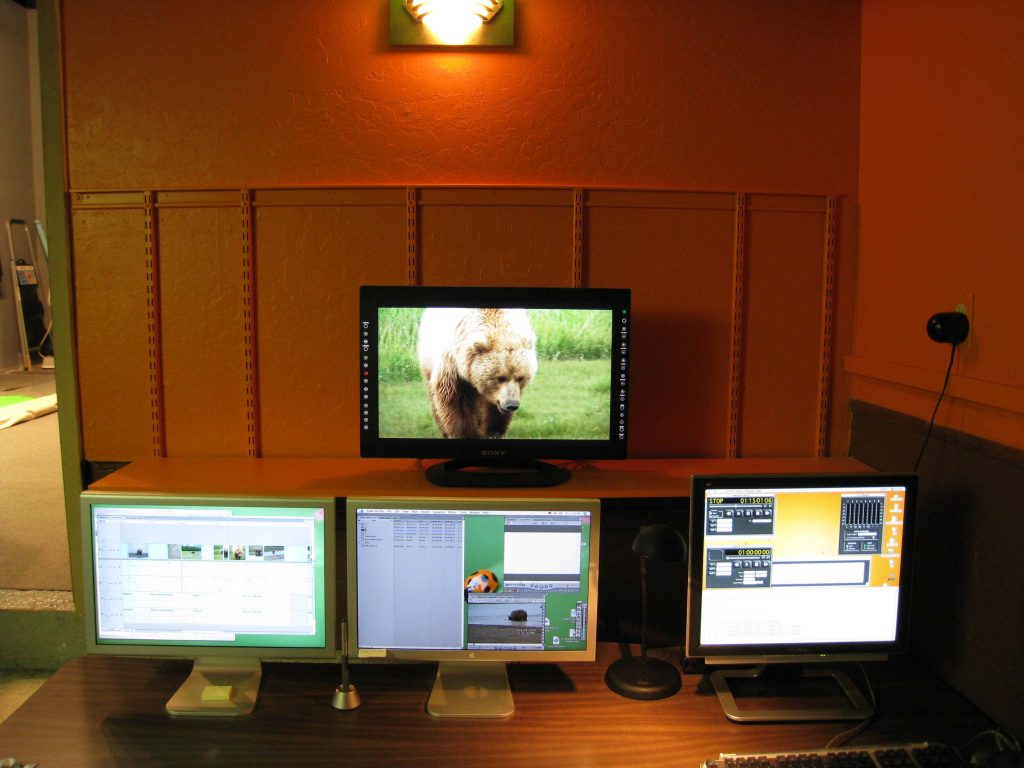 Computer and video monitors at editing and DVD authoring workstations